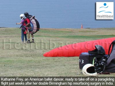 Katharine Frey taking off on a paragliding flight just weeks after her hip resurfaicng surgery in India